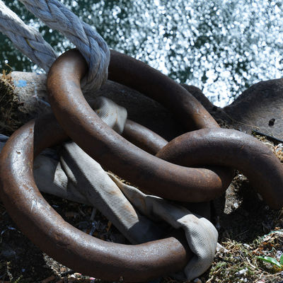 Chain Close-up Connection Day Durability Focus On Foreground High Angle View Land Metal Nature No People Outdoors Protection Rock Rock - Object Rusty Safety Security Solid Strength