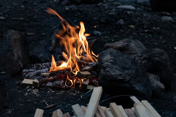 EyeEm Nature Lover EyeEmNewHere Bonfire Burning Campfire Close-up Coal Fire Fire - Natural Phenomenon Firewood Flame Glowing Heat - Temperature High Angle View Log Nature No People Orange Color Outdoors Rock - Object Solid Wood Wood - Material