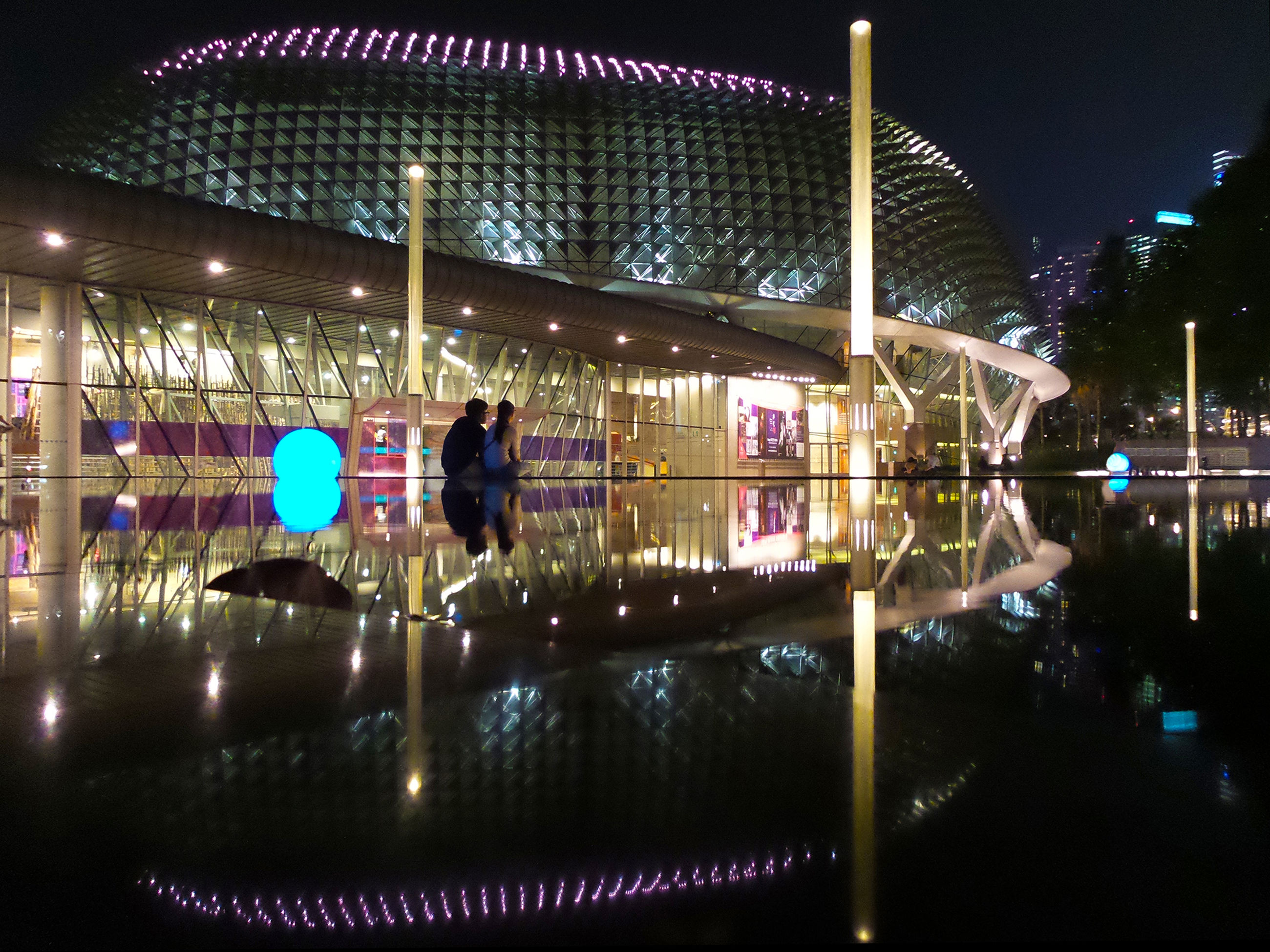 illuminated, night, built structure, architecture, lighting equipment, building exterior, reflection, street light, city, light - natural phenomenon, no people, outdoors, incidental people, electric light, long exposure, multi colored, building, arts culture and entertainment, sky, glowing