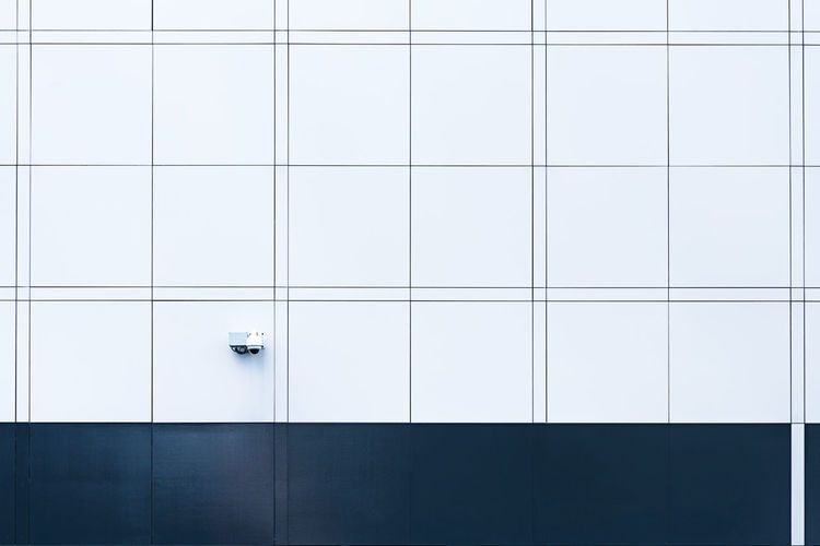 Security Camera On Tiled Wall