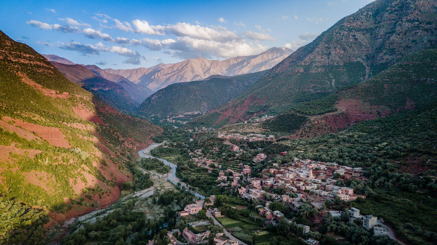 Landscape of the civilization in the mountain valley of Morocco. Lost In The Landscape Morocco Nature Beauty In Nature Civil Civilization Cloud - Sky Day Hometown Idyllic Landscape Mountain Mountain Range Nature No People Outdoors Scenics Shadow Sky Tranquil Scene Tranquility Travel Destinations Wallpaper
