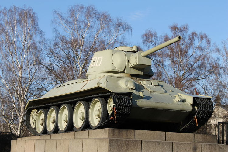 Low Angle View Of Military Tank Memorial Against Sky