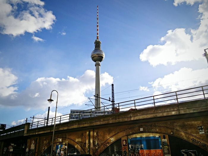 Low Angle View Of Bridge By Fernsehturm Against Sky