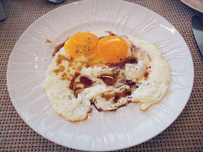 Close-up of fried egg served on plate