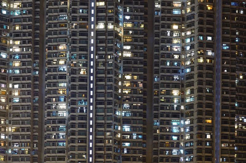Full frame shot of illuminated buildings at night