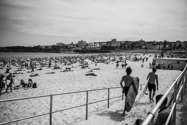 Surfers at Bondi Beach in Sydney Bondi Beach Surfers Water Real People Men Architecture Nature Sky Streetwise Photography Leisure Activity Lifestyles Sea Railing Built Structure People Day Group Of People Women Land Building Exterior Adult Outdoors Beach My Best Photo The Art Of Street Photography The Art Of Street Photography