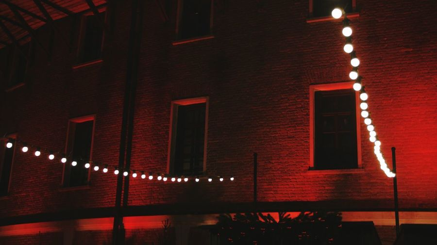 Illuminated red lights on wall