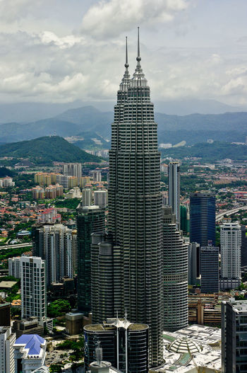 Overview Farsightedness Architecture Buildings Buildings & Sky Capitol Foresight Kuala Lumpur Malaysia Overview Petronas Twin Towers Places I've Been Sky Sky And Clouds Structure View