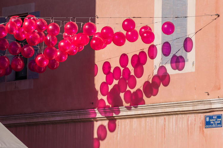 Balloons reflection. Architecture Balloon Balloons On A Building Balloons Relection Built Structure Celebration Close-up Day France From A Tourist Perspective Hanging Helium Balloon Indoors  Light And Shadow Low Angle View No People Outdoors Pink Balloons Pink Color Provence Red Rosé Rosé Wine Day South Of France Wine Tasting