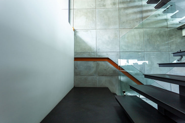 View of building staircase by wall