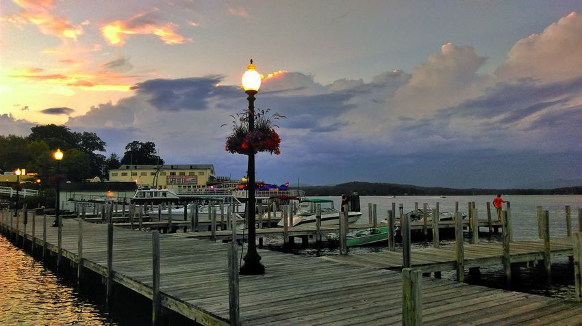 Evening at the Lake Relaxing Pier Lake Lake Winnipesaukee Weirsbeach Sunset Clouds And Sky Beauty In Nature The Essence Of Summer Docks Boats Miles Away