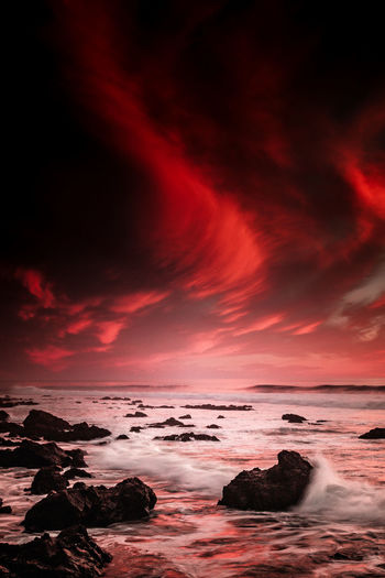 Beach Beauty In Nature Dramatic Sky Extreme Weather Landscape Nature No People Outdoors Red Reflection Scenics Sea Sky Sunset Water