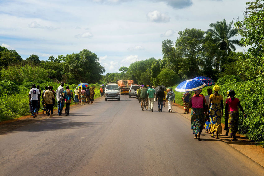 Africa Colors Congo Documentary Exploring Exploring New Ground Full Frame Journey Outdoors Palm Trees Photojournalism Real People Reportage Road Showcase: December Street Sunny Day Taking Photos Transportation Travel Travel Photography Traveling Travelling Walking