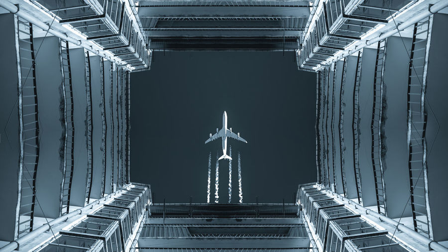 Directly below shot of airplane flying against sky