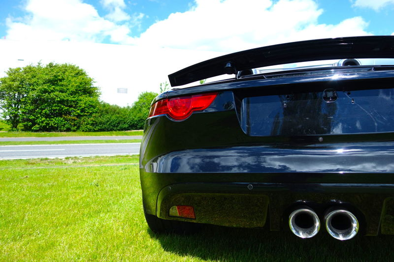 Back View Behind Black Cabrio Cabriolet Car Carlovers Close-up Exhaust Exhausts Field Grass JAGUAR Jaguar F-Type Jaguars Outdoors Parked Pipes Sky Sports Car Tail Light