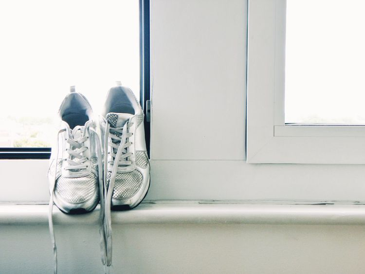No People Indoors  Window Day Shoes White Shoes Light Old Shoes Shoes At The Window Room White Background Domestic Room Copy Space Casual Shoes
