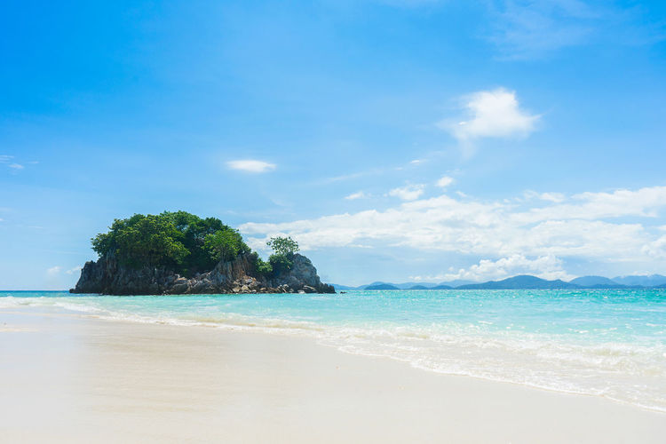 Sandy beach and bright sky at Phi Phi Island Sea Sky Land Water Beach Beauty In Nature Scenics - Nature Cloud - Sky Tranquility Tranquil Scene Nature Day Idyllic Horizon Over Water Blue Sand Outdoors No People Horizon Turquoise Colored