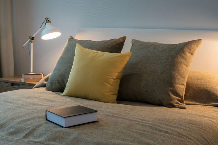 Book on bed at home