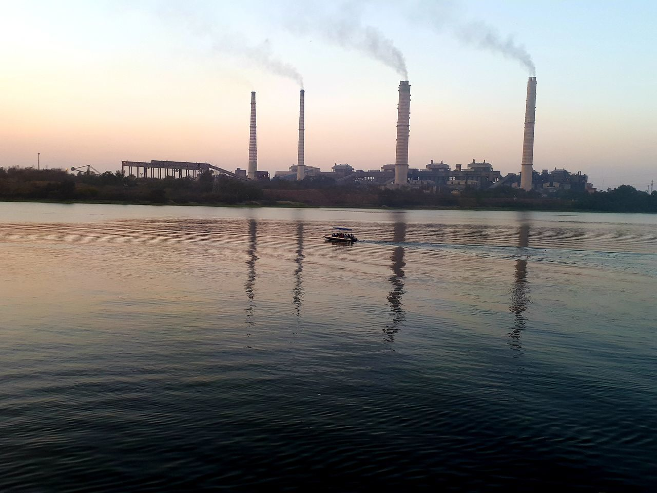 factory, smoke stack, building exterior, pollution, industry, water, environmental issues, sky, smoke - physical structure, built structure, emitting, architecture, air pollution, reflection, waterfront, environment, chimney, smoke, nature, no people, fumes, outdoors, atmospheric, cooling tower