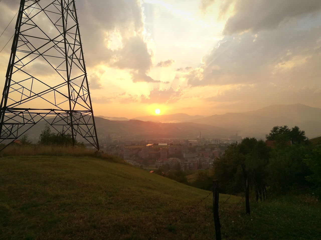 sunset, sky, architecture, built structure, no people, landscape, nature, outdoors, electricity pylon, grass, city, beauty in nature, tree, day