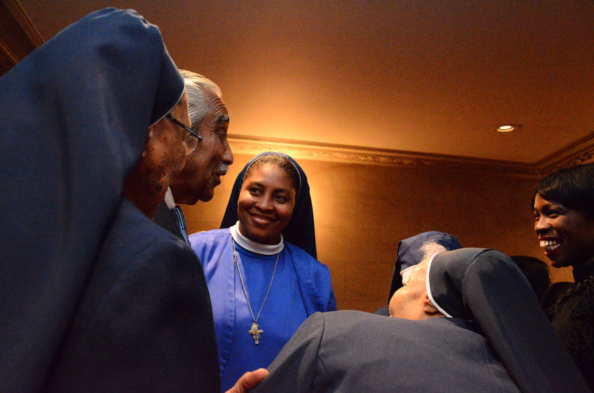 Order of African American nuns from the Franciscan Handmaids of the Most Pure Heart celebrates 100 years of service in the Harlem Community. African American Nuns Black Nuns, Catholic Religion, The Photojournalist - 2018 EyeEm Awards Adult Group Of People Harlem  Indoors  Leisure Activity Lifestyles Low Angle View Males  Mature Adult Mature Men Men People Real People Sitting Smiling Togetherness Waist Up Women