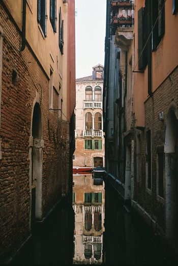 Venice Analogue Photography Film Mirroring Travel Arch Architecture Building Building Exterior Built Structure Canal City Film Photography Filmisnotdead Filmshooters History Mirroring In Water Nature No People Old Outdoors Residential District Traveling Photography Wall Water Window