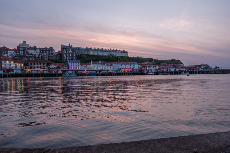 Whitby Whitby Harbour Whitby View Whitby North Yorkshire North Yorkshire North Yorkshire Coast Seaside Seaside Town Coastal Water Cloud - Sky Waterfront Dusk River No People Outdoors Cityscape Sky Architecture Building Exterior Sunset Nautical Vessel Built Structure Building