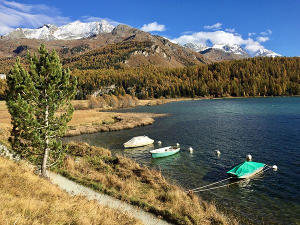 Swissalps Graubünden Schweiz Automn Colors Automn Lake Mountains Boats Nature Tranquil Scene Tranquility Scenics Beauty In Nature Mountain Sky Day No People Landscape