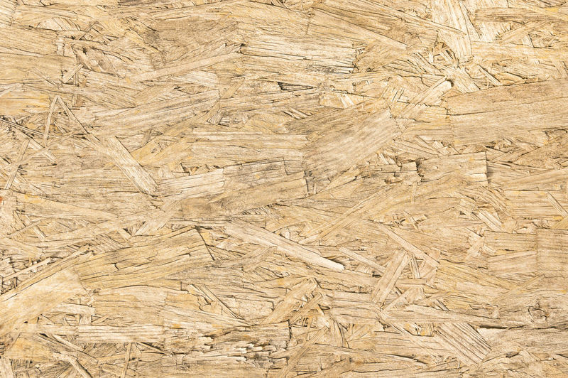 Chipboard wood background and alternative construction material - Texture on wooden panel in construction yard - Retro seamless backdrop pattern - Pressed particleboard for house isolation coating Wood Wood - Material Wooden Woodwork  Background Backdrop Pattern Textured  Texture Chipboard Alternative Ecological Recycling Material Cheap Light Panel Construction Seamless Pressed  Plywood Structure Protection Fence Furniture