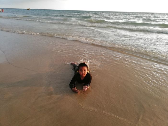 Children enjoy on summer trip 2019,หาดเจ้าหลาว Achi2019 Sea Water Beach Land Horizon One Person Real People Horizon Over Water Leisure Activity Motion Lifestyles Portrait Wave Nature High Angle View Beauty In Nature Sand Day Outdoors Boy