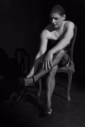 Adult B&w B&W Portrait Black Background Dramatic Lighting Introspection Loneliness One Person Rehearsal Sitting Stage Studio Shot Theater Transgender Travesty Young Adult