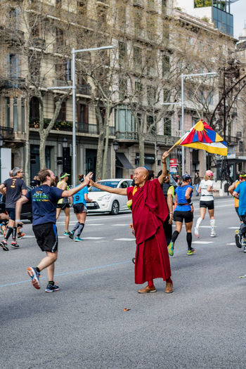 Sharing love, energy and a strong message.Thubten Wangchen director of Fundació Casa del Tibet de Barcelona. Adult Barcelona Buddhism City Day Flag Fundació Casa Del Tibet Happiness Human Rights Human Rights Movement Lifestyles Marathon Maraton Marató Barcelona 2017 Marató De Barcelona Monk  Outdoors People Portrait Of A City Running Sport Street Tibet Tibetan  Tibetan Buddhism Resist