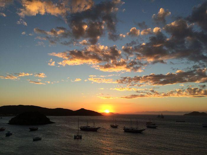 Brazil, Buzios, abril/2016 Beauty In Nature Boat Brazil Buzios Calm Cloud - Sky Nautical Vessel Ocean Orange Color Scenics Sea Sky Sunset Tranquil Scene Tranquility