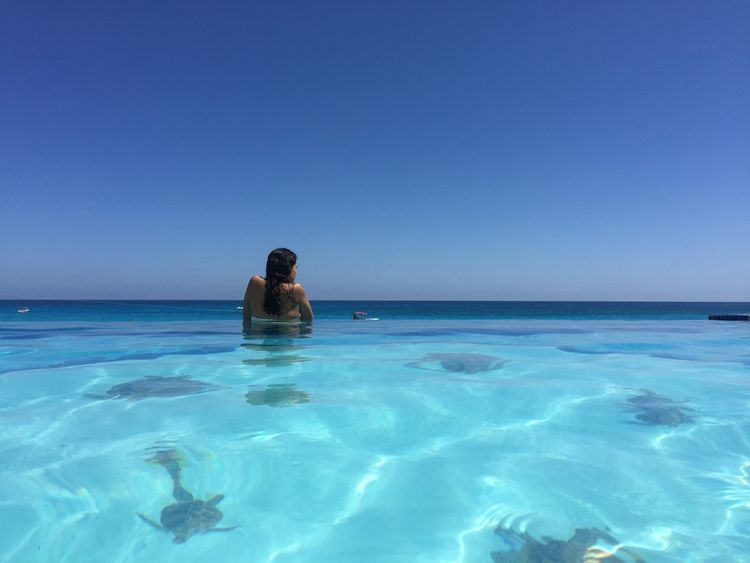 Sea Water Copy Space Horizon Over Water Clear Sky Blue One Person Tranquil Scene Beauty In Nature Nature Tranquility Swimming Pool Scenics Waterfront Vacations Relaxation Day Outdoors Women Real People Cancun Mexico Mexico