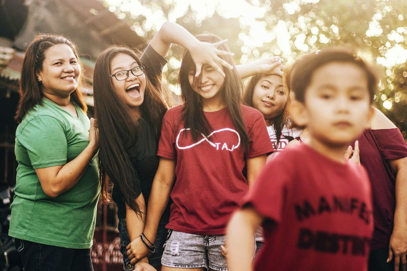 Friendship Togetherness Teenager Day Fun Enjoyment Cheerful Candid Outdoors People Leisure Activity Young Women Sunlight Sunshine Sunbeam Human Face Happiness Love Family Sisters