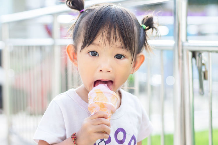 Portrait of girl eating ice cream
