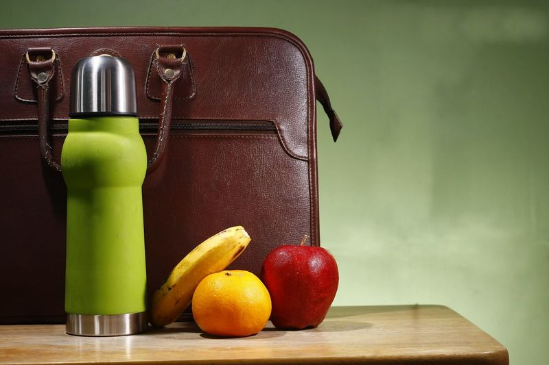 Coffee, apple, orange, banana, and a briefcase. Coffee Coffee Time Coffee Break Caffeine Apple Banana Orange Drink Drinking Beverage Food And Drink Nutrition Healthy Lifestyle Healthy Eating Diet & Fitness Lunch Health Snack Fitness Bottle Diet Briefcase Attache Bag Portfolio