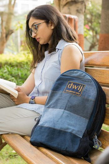 Upcycling Items Upcycling Upcycled Bag Upcycled Waiting Recycled Materials Jeans Small Bag Bag Jeans Bags Bags Reading Knowledge Studying Young Women Sitting Women Book University Student Denim Jacket Casual Clothing Park - Man Made Space Denim Park Bench Bench Park Diary Publication Sketch Author