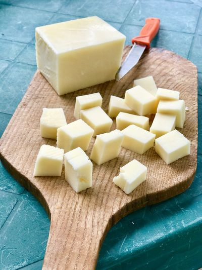 Yellow cheese Food Food And Drink Indoors  High Angle View Freshness Cube Shape No People Still Life Cheese Dairy Product Table Shape Kitchen Utensil Close-up Preparation  Wood - Material
