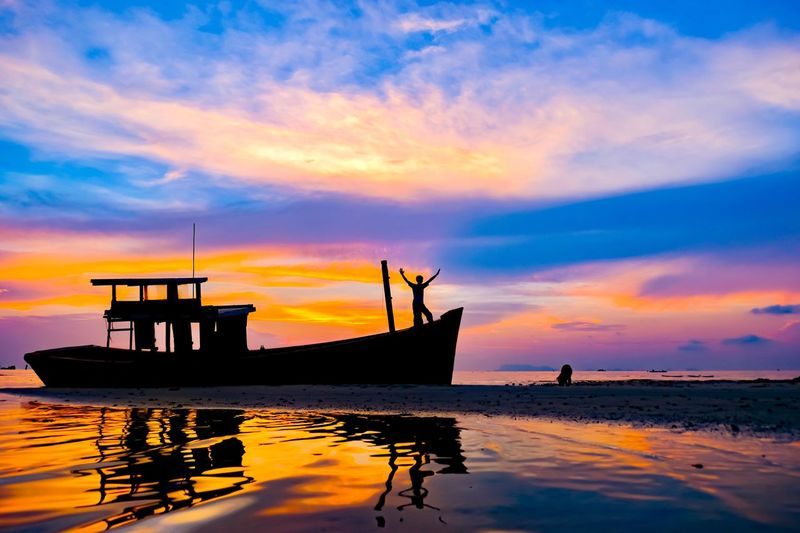 Water Sunset Cloud - Sky Sky Nautical Vessel Sea Orange Color No People Beauty In Nature Scenics - Nature Mode Of Transportation Transportation Nature Reflection Silhouette Tranquil Scene Tranquility Moored Waterfront Outdoors