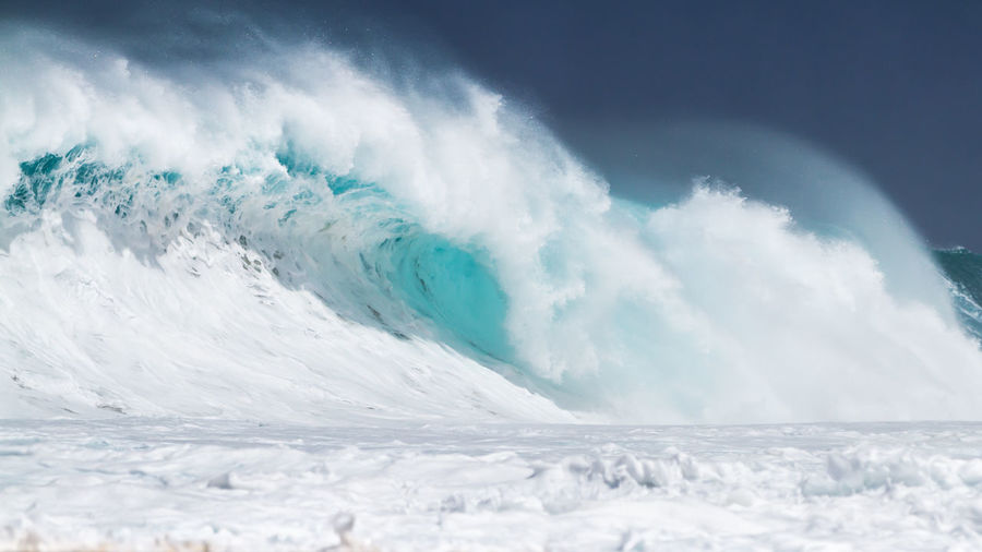 A Giant Ocean wave breaking on the north shore of Oahu Hawaii BIG Breaking Giant Hawaii Oahu Surf Wave Beach Beauty In Nature Blue Foamy Motion Nature No People North Shore Ocean Outdoors Power In Nature Scenics Sea Splashing Turquoise Water Waves White