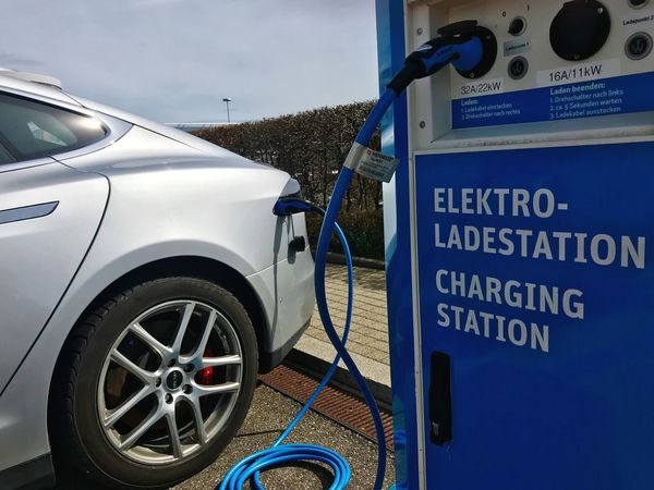 Charging a Tesla at Stuttgart Airport Stuttgart Airport Tesla Model S Tesla Motors Tesla Electro Mobility Charging Electric Car Charging Station Charging Electric Car Mode Of Transportation Transportation Motor Vehicle Text Communication Car Land Vehicle Day No People Close-up