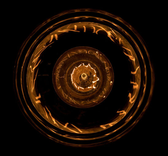 """Vintage style (""""Edison"""") LED bulb from underneath Indoors  Filament Black Background Illuminated Light Bulb No People Close-up Lighting Equipment Glass - Material Shape Circle Single Object Electricity  Dark Geometric Shape Light Transparent Directly Below Glowing Glass"""