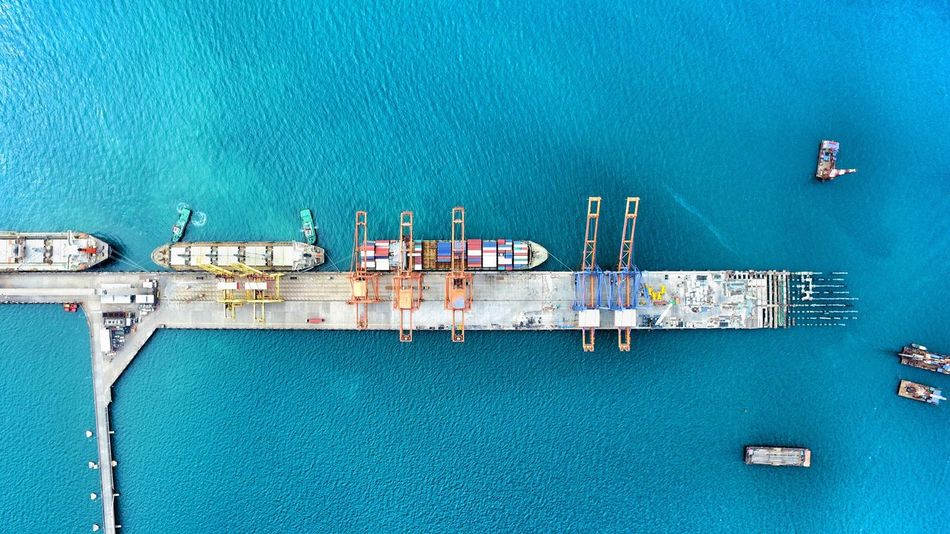 Flying High Transportation Water High Angle View Nautical Vessel Mode Of Transport No People Architecture Day Outdoors Contsiner Sky Industry Alongside alongside port Sea Transportation Shipping  Logistics Bulkcarrier jetty Berth Warehouse Nature Operation operate Export