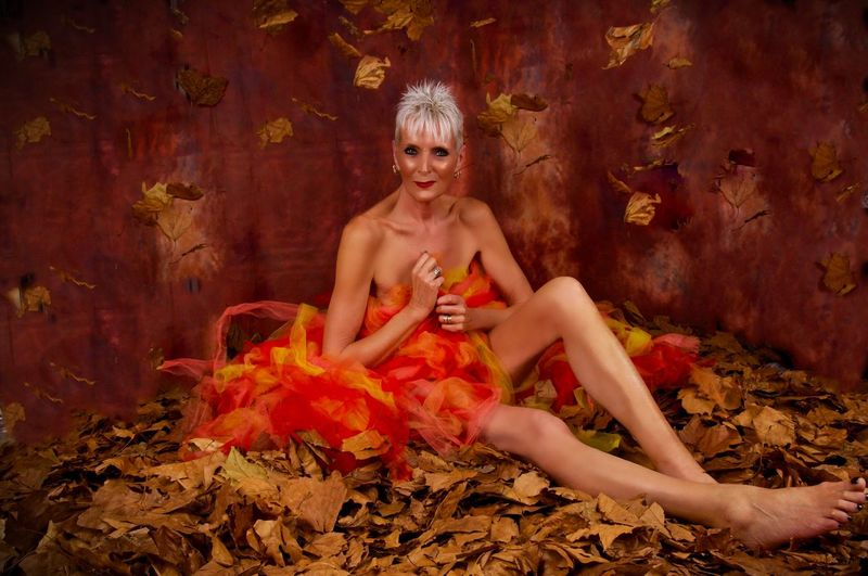 Leafs Tutu Sitting One Person Beauty Full Length Portrait Fashion Looking At Camera Young Adult Beautiful People Women Clothing Beautiful Woman Red Nature Front View Relaxation Hairstyle