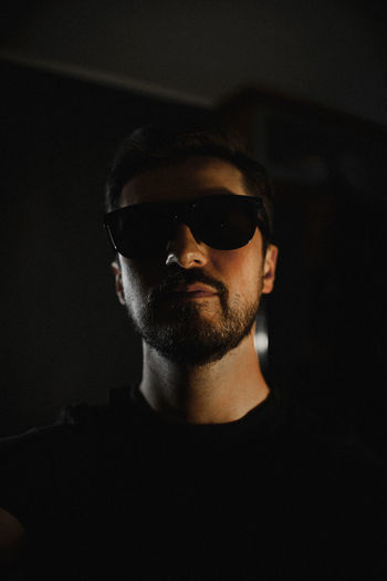 Portrait of man wearing sunglasses at home