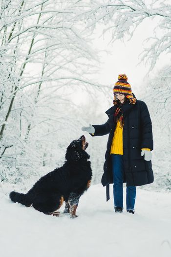 Woomen Girl Winter Snow Cold Temperature Mammal Domestic Animals Animal Animal Themes One Animal Pets Warm Clothing Dog Real People One Person Full Length Nature Outdoors Clothing Domestic