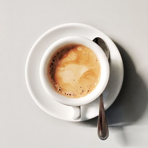 Coffee Cup Drink Coffee - Drink Food And Drink Refreshment Still Life Cup Directly Above Table Freshness High Angle View No People Beverage Close-up Saucer Indoors  Frothy Drink Studio Shot White Background Cappuccino