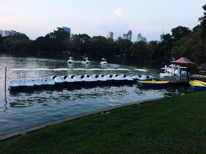 Boats in calm lake