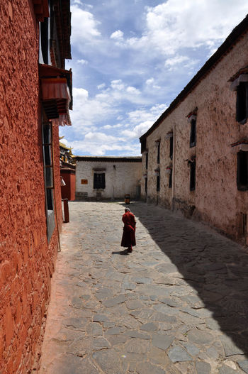 Tibetan buddhist monastery in Shigatse Architecture Buddhist Monastery Day Monastery Monk  Outdoors Shigatse Sky Temple Tibet Tibet Travel Tibetan  Tibetan Buddhism Tranquility Travel Travel Destinations Walk BYOPaper!